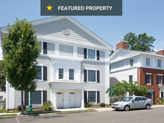 Dual-family, multi-location units showing a bright and inviting exterior with spacious on-street parking.
