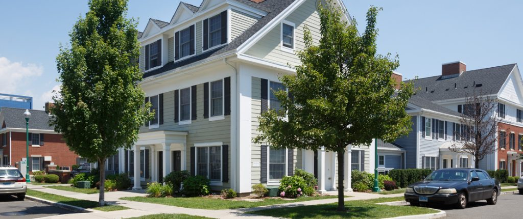 This inviting, corner building has many windows with faux shutters and covered entrances. Indented parking is available.
