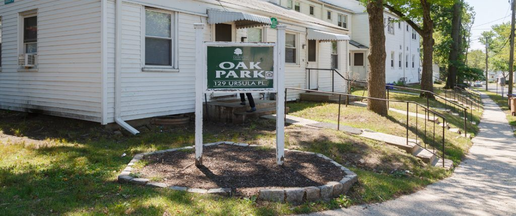 The Oak Park sign sits at the corner and features the Equal Housing Opportunity logo and reads Oak Place, 129 Ursula Place.